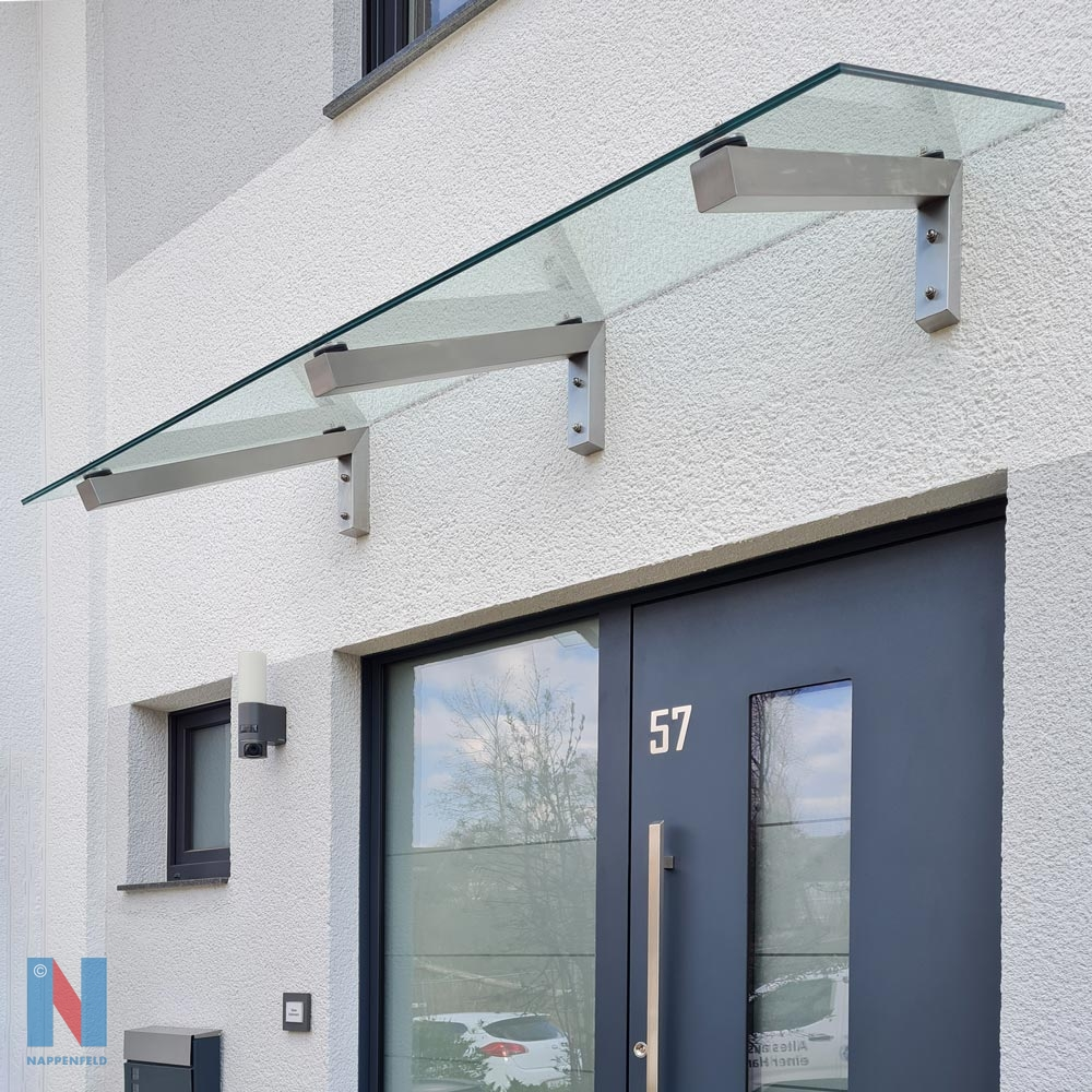 Vordach aus Edelstahl & Glas in Essen, gebaut und umgesetzt von der Edelstahlschlosserei Nappenfeld aus Mülheim