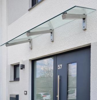 Vordach aus Edelstahl & Glas